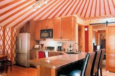 I *will* live in a yurt someday...check out www.pacificyurts.com to learn more about my future house :)