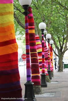 Yarn bomb. First heard about this in photography. You can be arrested if you are caught but it would be a blast to either see it and photograph it, or to do it