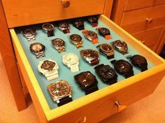 I bought some foam from a local shop (it is seating foam that they use to make seat cushions), cut it with a ....... knife to fit a spare drawer, cut out inserts suitably arranged and spaced for the watches and, hey presto, got me a nice new storage area for some of my watches :)