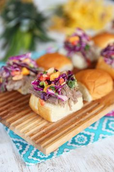 Kalua Pork Sliders with Pineapple-Mango Slaw...this pineapple-mango slaw really sounds good!!