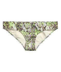 Fully lined bikini bottoms with scuba look. Neon snakeskin print. | H&M Swim