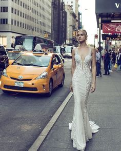 This sequin and lace embellished #DimensionsCollection gown stops traffic!