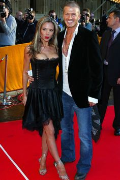Another shot of Victoria with her cleavage practically out. Something we dont want to see. Victoria Beckham