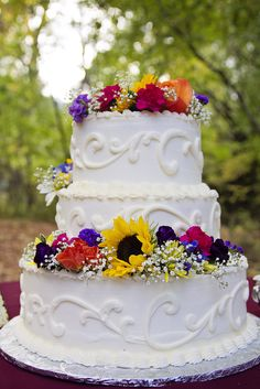 Colorful sunflower wedding cake