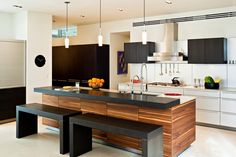 The sleek and modern Bulthaup kitchen with a breakfast bar designed for optimal functiomality.