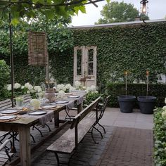 120 stunning romantic backyard garden ideas on a budge Farmhouse Garden, the wall of ivy with vintage door, long row of seating at patio table, brick pavers Outdoor Rooms, Outdoor Dining, Outdoor Gardens, Outdoor Patios, Outdoor Kitchens, Romantic Backyard, Water Features In The Garden, Terrace Garden, Garden Water