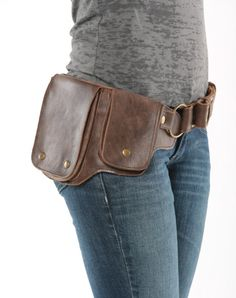 This beautiful bomber jacket brown leather and antique brass hardware utility belt is edgy and goes great with every style. The soft leather conforms to your waist. The adjustable straps ensure a perfect fit for any size. This utility belt is handmade with the best quality on the market. This holster type storage belt features two separate snap closure storage pouches and one large interior zippered compartment. One of the largest storage belts on the market, yet compact in design. This…