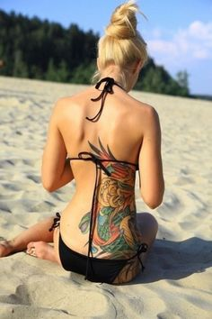 Beautiful placement and color of this tattoo!!!