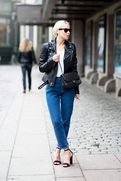 25 Ways to Make Mom Jeans Look Modern - classic combo: mom jeans, leather moto jacket, comfy white t-shirt, sexy barely-there strappy heels and Chanel   StyleCaster