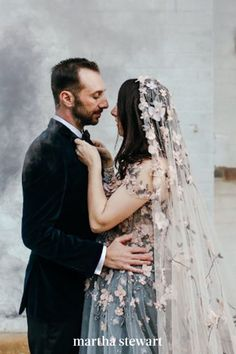 Your veil doesn't have to be the focal point of your big-day ensemble to make a statement. Here, we love how the romantic pink flowers throughout her veil referenced the same-colored appliqués on her gray-blue wedding dress. The result? A completely cohesive getup, from head to toe. #weddingideas #wedding #marthstewartwedding #weddingplanning #weddingchecklist Wedding Veils, Boho Wedding, Chapel Length Veil, Nontraditional Wedding, Blue Wedding Dresses, Bohemian Bride, Wedding Accessories, Weddingideas, Pink Flowers