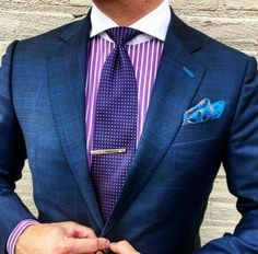 Ok, this is really nice combination. Purple and pink(ish) are really close to each others and blue works well with both. There's 3 main colors 1 extra shade of blue (pocket square and buttonholes) and white as neutral. More colors would be too much...