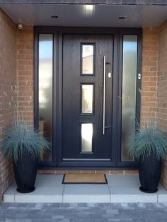 Contemporary grey front door grey with opaque sidelight window panels.