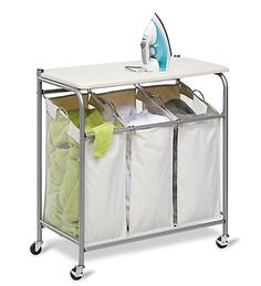 Honey-Can-Do SRT-01196 Sort and Iron Triple Laundry Center, Natural / Silver. This dual purpose laundry station features a built in ironing board that lifts ups easily to expose a full-featured triple sorter below. The thick foam pad and heat resistant, 100% cotton cover provide a smooth ironing surface every time. The sorter boasts three removable polyester bags, which make for simple sorting and convenient carrying and washing. The laundry bags incorporate mesh sides for ventilation an...