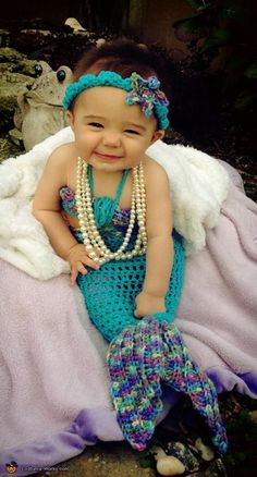 Polly McCullough...I so see this in your project basket now! Baby Mermaid - 2013 Halloween Costume Contest