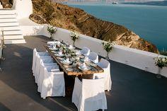 KIRINI Suites & Spa Santorini | long wood table.