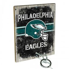 Team Toss for Philadelphia Eagles fans from Team ProMark is a fun and addictive game that's easy to learn but difficult to master. Toss the ring on the eye hook and score a point. The vintage team board designs make a great addition to any fan cave or game room wall. Play individually or pair up for teams while the gang is over watching the game.