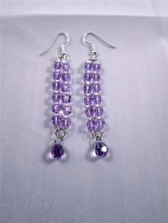 Crystal and silver seed with a purple dangle.