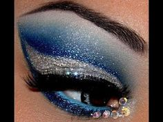 Bold blue and silver glitter eye make-up with crystal accents.