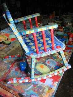 many beautiful painted chairs at web site