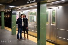 Engaged couple cuddling at Times Square metro station platform. Pre-wedding engagement photo session at New York City, NY, by wedding photographers of Leo Dj Photography. http://leodjphoto.com