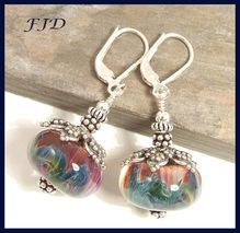 These boro beads are individual works of art (Daniel Echeverry)  Boro Lampwork Glass and Sterling Silver Earrings