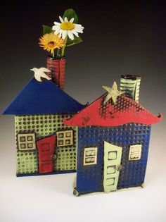 House Vases. $58.00, via Etsy. Could easily do this with recycled materials too!  Fabulous idea!