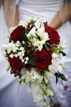 i like the berries in this...  red & white bouquet I love the colors if it is for a winter wedding (: