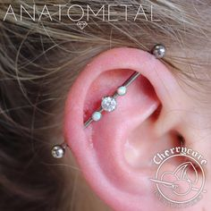 This here is a lovely fresh 14g industrial piercing that we did using all Anatometal titanium pieces! This was a piece that we had already put together in our jewellery displays, and we can do so so many more combinations to customize these...