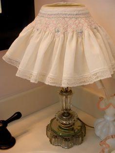 What a cute idea! A vintage lamp 'skirt'!