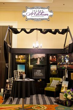 Bridal show booth | Charleston Bridal Show | Charleston Wedding Photographer Hand painted rug, chalkboard signage, some old vintage furniture, canvas prints, a huge plasma, and oreo truffles (not seen in the photo).