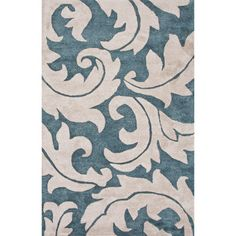 Anchor your living room seating group or define space in the den with this hand-tufted wool rug, featuring an acanthus leaf motif.   ...