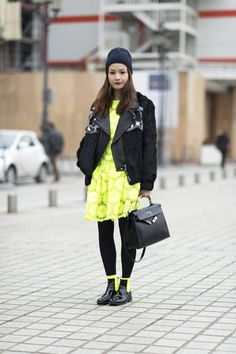 Très Chic! The Best Street Style at Paris Fashion Week: A cool-girl leopard coat and tomboy beanie pulled denim and a tee together with a little edge.  : The textural play between her coat and trousers was a chic combo unto itself; the footwear just furthered the appeal.  : A testament to the power of neon.  Source: Le 21ème | Adam Katz Sinding