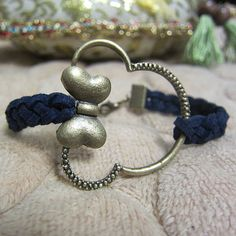 Mickey Mouse bracelet with dark blue strings by uptowngirlworld, $5.99