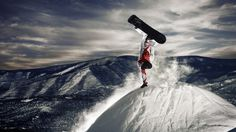 Download Wallpaper Snowboarder - stunt on top of a mountain - 2560x1440