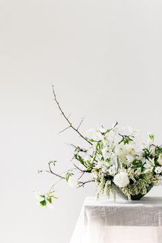 textural all white wedding flower arrangement