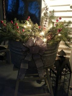 Easy Christmas porch decor idea: fill any metal or wood bucket or wicker basket… Outdoor Christmas Decor Porches, Christmas Porch Decorations, Lantern Christmas Decor, Primitive Christmas Decorating, Holiday Decorating, Prim Christmas, Christmas Baskets, Porch Decorating, Country Christmas