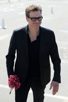 Colin Firth was given a surprise bouquet of red roses...  • Celebrity WOTNOT ------------------------ For further information on this story and image please visit www.celebritywotnot.com. These Images are ©Atlantic Images. No use without permission. Please contact Atlantic Images for licensing.  This video is copyright Atlantic Images. Please contact Atlantic Images for licensing. No use without permission.