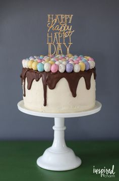 Festive spring-inspired Easter / Birthday cake made with mini Easter eggs. | inspiredbycharm.com