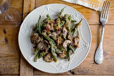 "NYT Green Bean Casserole by Martha Rose Shulman -- ""The cream of mushroom soup is replaced with crème fraîche and sautéed mushrooms; bacon and Gruyère are added to the mix; fresh green beans stand in for frozen ..."""