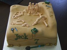 Dinosaur dig - Jack's dinosaur dig cake...full of gumpaste bones and paleontology tools fit for an adventurous 7 year old! Cake is a s'mores cake with marshmallow mousse. I love how this cake turned out!