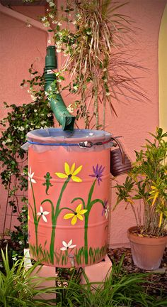 Installed Rain Barrel. Instructions on how to assemble and paint...
