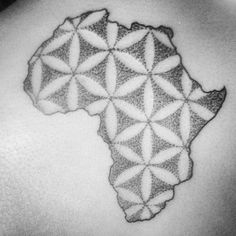African map tattoo with flower on Amrita Haricharan by Kyle Kemp - Flower of life dot work in the motherland