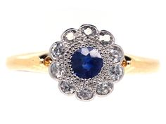 A pretty sapphire and diamond daisy cluster ring that is in very good condition. This style was very popular in the 1900s so this ring was made circa 19001-1910. The shank is 18ct gold and the stones are set in platinum. It would be ideal as an engagement ring.