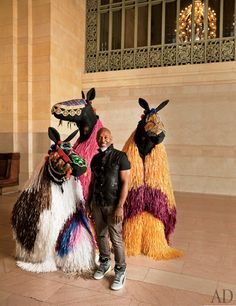 Nick Cave stands with his raffia horses at Grand Central Terminal. That was a genius performance!
