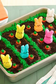 his festive bunny garden cake is quick and easy to make, thanks to the help of these adorable PEEPS® marshmallow bunnies.