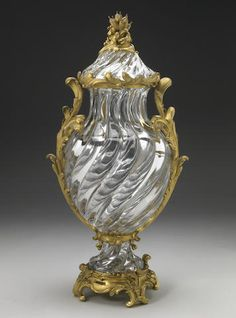 A Baccarat gilt bronze mounted crystal vase and cover