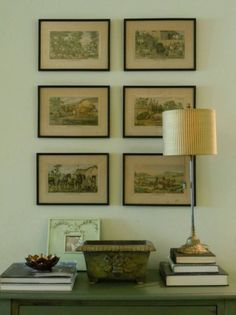 6 Serene Green Paints That Don't Say Green | my den | vignette with vintage art prints | walls - Benjamin Moore SPRING BUD 520 was perfect for this dark, north facing room with a hill behind the house | interior design and photo by Laurel Bern
