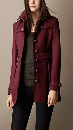 Burberry coat for $1295.00 Canadian. Enjoy the burgundy colour and the styling detail of the buttons. The buttons give this coat a clean but simple look.