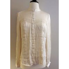 MNG by Mango Vintage Style Blouse Gorgeous MNG by Mango cream colored vintage style blouse. Strip of lace over bust area. Tuxedo pleats down front. Size 4. No known flaws. ❌ NO TRADES ❌ NO PP❌ NO LOWBALLING ❌ Mango Tops Blouses