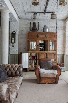 A massive vintage icebox makes a period statement and now serves as a bar in this urban loft.